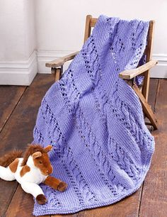 "Darlene Dale has designed one of the most satisfying and sumptuous baby blankets we've seen in a while. Stitched in our quick-knit Simply Soft Chunky, the Cables and Lace Baby Blanket is sure to become the favorite naptime ""blankie"" of your favorite tot."