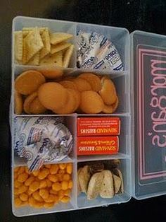 Tackle box=travel treats.  Each child gets one box of goodies for the trip, and when the box is empty... no refills.  Nothing to throw away.  No fighting!