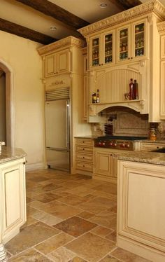 White-ish cabinets. Versaille pattern tile. Old World Tuscan Kitchen Style