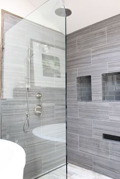 12x24 tiles all the way to the ceiling with minimal grout lines via design - Bathroom Tile Designs Ideas