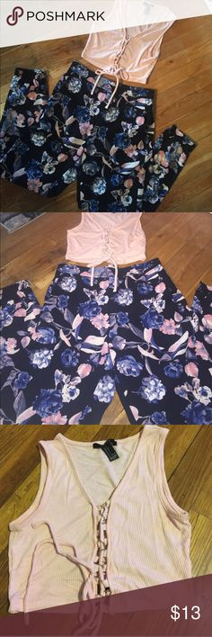 FLORAL SUMMER OUTFIT - LIKE NEW Super cute outfit - lace down pale pink crop top size small- with floral skinny elastic band bottom pants size small pants colored black/blue with pale pink , purple- super cute to dress up with heels- worn once Forever 21 Pants Jumpsuits & Rompers