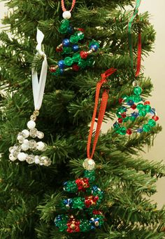 Easy Christmas Crafts Spiral Beaded Christmas Ornament four finished ornaments hanging on tree