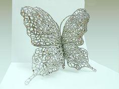 #Mariposa plateada. #Decoracion #Navidad al mejor precio, €1.15