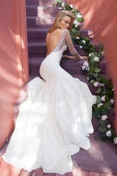 A stunning long sleeved and open back wedding dress from @katiemayla. #gown #dress #bride #wedding #love