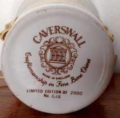 Vintage Caverswall fine bone china royal commemorative beaker. It was made in a Limited Edition of 2000..( this one being number 618 )..to commemorate the 25th anniversary of The Queens Coronation. It has golden lion head handles.  Decorating one side of the beaker is a colour illustration of a royal state coach with one white horse visible, and surrounded by footmen in red coats. Above is a crown and around it is a laurel wreath.  Written upon the other side are the words: To celebrate the…