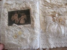 journal page ...  vintage fabrics, lace, voile. buttons  and a photograph which has been sewn into the page using a running stitch. If you're not good at hand sewing you could do this step using a sewing machine - it would look great either way.  Fabulous pages.