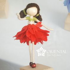 The little girl in her red flower petal dress is hopping to the forest. And she has no face. Do you know the story of no-face doll? Check it out