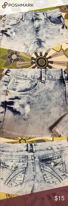 Rue 21 acid wash shorts with fraying Size7/8 Acid wash short shorts with pocket detail and frayed patches on front of short. Shorts give the appearance of cutoffs with fraying at hem Rue21 Shorts Jean Shorts