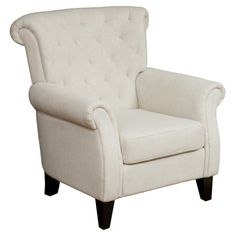 A cozy addition to your living room seating group or favorite reading nook, this tufted arm chair showcases a rolled back and light beige upholstery....