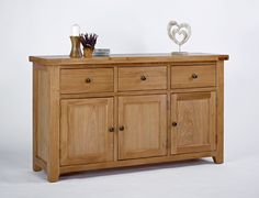 Devon Oak 3 Door 3 Drawer Sideboard The Devon Oak 3 Door 3 Drawer Sideboard is a chunky and well proportioned piece which is supplied fully assembled. Crafted using artisan methods of joinery, this sideboard features three dovetailed dr http://www.MightGet.com/january-2017-13/devon-oak-3-door-3-drawer-sideboard.asp
