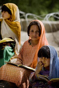 Afghanistan: Girls attend an informal school outside a mosque in the Mian Poshteh Bazaar.