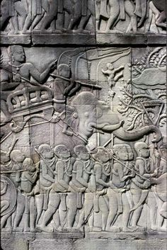 Proud armies with elephants march in extensive bas-reliefs in the Bayon  Cambodia