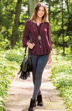 A Kind of Magic   Create a look that's simply spellbinding in our crochet bib swing top and faux suede skinny pants. A studded fringe crossbody, feather fringe necklace and fringe ankle boots finish the formula for your style adventure.