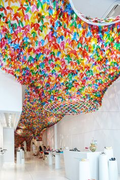 Installation featuring 20,000 translucent flowers created for a shoe shop.