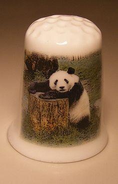 Panda on tree stump porcelain thimble These are for sale by https://www.speelgoedenverzamelshop.nl/vingerhoedjes/dieren/panda_op_boomstronk_op_een_porselein_vingerhoedje_(hmpan01).html