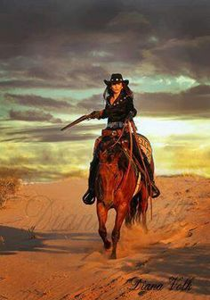 ~ Yeah, that's Arizona's own Diamond Cowgirl Bobbi Jeen Olson on horseback and decked out in black.  According to her stance and the speed of her horse she means business and the rifle is about to speak for her! ~