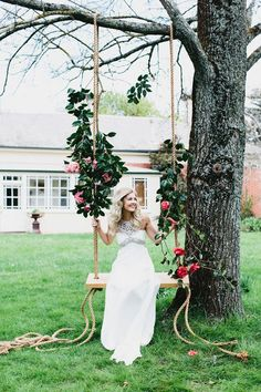 Pretty bride on a garden swing -