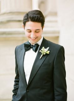 A dapper groom wearing a classic black tux and bow tie. #wedding #style #fashion
