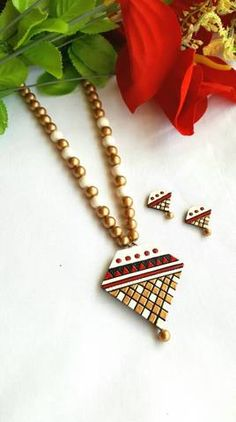 Golden White and Red Triangular Pendant Terracotta Jewellery Set Terracotta Jewellery Making, Terracotta Jewellery Designs, Terracotta Earrings, New Necklace Designs, Teracotta Jewellery, Jewelers Near Me, Jewelry Stores Near Me, Handmade Jewelry Designs, Handmade Jewellery