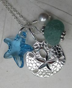 Sea Glass and Sand Dollar Necklace-  A Cluster of Treasures Necklace with Aqua SeaGlass. $30.00, via Etsy.