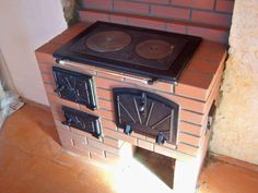 Mini Wood Stove, Rustic Outdoor Kitchens, Drop Down Table, Wood Stove Cooking, Outdoor Fireplace Designs, Modern Bungalow House, Outdoor Kitchen Countertops, Pizza Oven Outdoor, Built In Grill