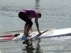 Everyone worries about getting on a Stand Up Paddleboard. There are several ways to accomplish it. You can set the nose against a flat surface, such as a boat dock, and walk onto the board. You can start on your knees, and stand up once you get into deeper water. Or much like surfing, you can lay on your stomach, and stand once you paddle out a bit.