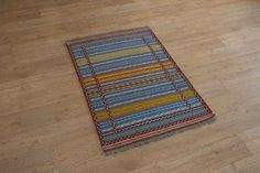 Hand Woven Kordy Kilim from Iran (Persian). Length: 117.0cm by Width: 80.0cm. Only £120 at https://www.olneyrugs.co.uk/shop/kilims-for-sale/persian-kordy-21100.html    Behold our fetching collection of hand made rugs, carpets, kilim foot stools and Kilim bags at www.olneyrugs.co.uk