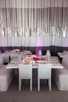 A mixture of white chairs and banquettes surrounded each custom white & gray wrapped square table.  Design by Alchemy Fine Events