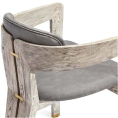 A distressed charcoal faux leather seat perfectly complements the taupe ceruse-finished wood frame of the eye-catching Maryl Dining Chair with brushed brass detailing.
