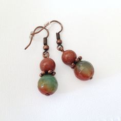 These pretty earrings feature beautiful round orange and green agate gemstones, shiny round shimmering copper beads and copper spacers and hooks. Orange Earrings, Copper Earrings, Gemstone Earrings, Drop Earrings, Green Agate, Agate Gemstone, Turquoise, Gemstones, Beads
