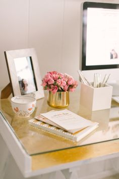 Trendy girly white pink and gold office decor: http://www.stylemepretty.com/living/2016/09/26/secrets-to-making-big-things-happen-in-your-career/ Photography: Ruth Eileen - http://rutheileenphotography.com/