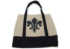 """Fleur De Lis bag is perfect for social events or a day out. Canvas has fabric handles 16"""" height X 16"""" width bead accents, zipper closure"""