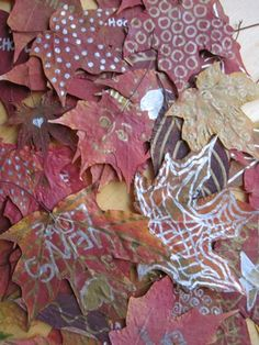 Doodling on pressed leaves with metallic sharpies....