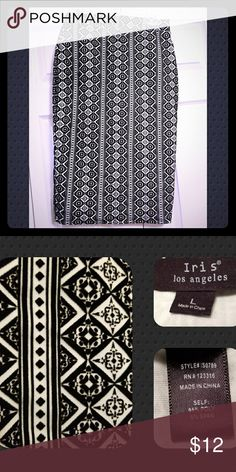 🍑 Black/White Skirt Iris black/white raised pattern skirt.  EUC.  🍑🍑🍑🍑🍑🍑🍑🍑🍑🍑  Offers welcome.  ♡  Love the listing but not the price.  ➕Add to Bundle and I'll make you an offer.  Smoke/Pet Free Home   Thank you for stopping by my closet.  Let me  know if you have any questions.  🎵🎢♥️ Iris Skirts Midi