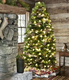 Rustic fireplace with a simple but lovely Christmas tree.
