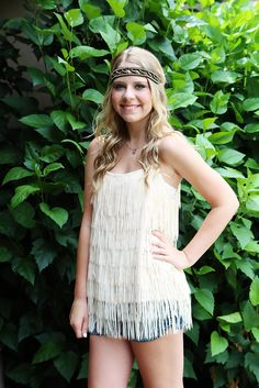 "You will be the author of your very own story when you wear our ""too cool""  Fringe Tank!  Use your imagination to dress this one up....or dress it down!  Looks fabulous when worn with any of our jeweled headbands!"