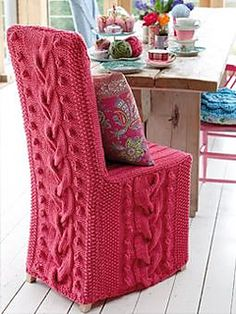 Super-chunky cover, with cables and bobbles- suitable for a dining chair. Simple panel construction. Simple cables - no complicated patterns. Includes chart for back panel.