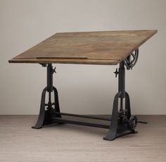 RH's 1910 American Trestle Drafting Table:Like those of the early 20th century, our drafting table is crafted of cast iron topped with a broad wooden work surface that lifts, lowers and tilts to suit the worker or the task at hand. The substantial, bell-curved trestle base offers excellent stability through the full range of settings.