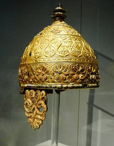 celtic parade helmet -Agris, France, about 350 BC.  This impressive piece of art was buried in a cave in Agris, western France. The entire cap, neck guard and cheek guards were all cluttered with lavish gold tendril and leaf design. Together with the gold, red coral inlays provide an effectual contrast.   Art of the Celts, Historic Museum of Bern.