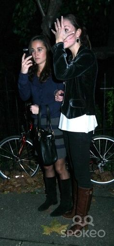 """Kate Middleton... I think this look means """" I don't want to have my photo taken, at this time fellas!"""""""