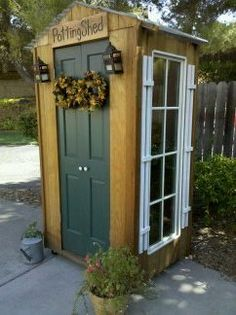 Small potting shed made of old repurposed windows and doors