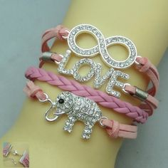 Elephant Bling Bracelet✨3 available✨ Pretty sparkly bracelet on pink cords.  It measures about 7 inches plus it has an adjustable chain on the back. New in package! Jewelry Bracelets
