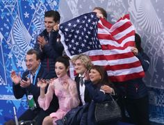 SOCHI, RUSSIA - FEBRUARY 08: Meryl Davis and Charlie White of the United States wait for their score with teammates and coaches during the Figure Skating Team Ice Dance - Short Dance during day one of the Sochi 2014 Winter Olympics at Iceberg Skating Palace on February 8, 2014 in Sochi, Russia. (Photo by Matthew Stockman/Getty Images)