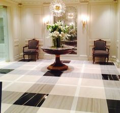 Stunning, creative use of 4 different marbles to create this plaid floor. Brunschwig & Fils showroom, NYC