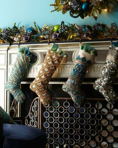 "10 Holiday Stockings Filled With Style (Not Coal): The intricate beading and detail in these ""Blue Spruce"" Christmas Stockings ($105) will add glamour and luxury to your holiday decor."