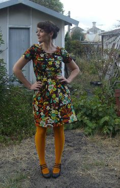 Floral dress and mustard tights.