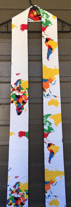 This reversible stole has the globe on a white cotton background with the flags of the world on the opposite side! It would be a unique stole for Communion, a wonderful Christmas gift! The width at the neck is 3 1/2 inches and 4 1/2 inches at the end. Message me with the height of the person receiving the stole so I can custom hem it to the appropriate length. This will usually ship within 7 days of receiving the height/hem length! This will arrive in a coordinating gift box,...