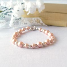 Girls Flower First Communion Bracelet in Dusty Peach  Swarovski Pearls With a Star Dust Spacers Beads