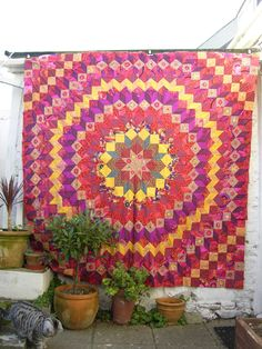 """""""Wheel of Fortune"""" quilt made in a Kaffe Fassett workshop, by Gisele at Art Escapes (UK).  This design is on the cover of KF's 'Caravan of Quilts'"""