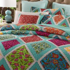 Get lost in the mystical fairy forest glade, accented with a multi-colored floral patchwork design. This set comes with one quilt coverlet and two pillowcases. Bright and vibrantly beautiful this set will add a touch of excitement to any room. Quilt Cover Sets, Quilt Sets, Colchas Quilting, Quilting Ideas, Big Block Quilts, Quilt Blocks, 24 Blocks, Layer Cake Quilts, Charm Quilt